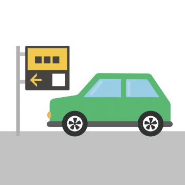 パーキングに入る緑の車のイラスト